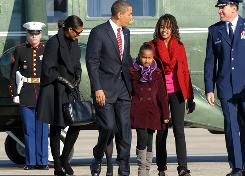 President Obama and the first family arrive at Andrews Air Force Base today on their way to Hawaii for Christmas vacation.