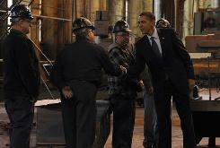 President Obama greets workers of Allentown Metal Works during a tour of the factory in Allentown, Pa., on Dec. 4. An analyst says workers at large companies who get insurance from their employer probably won't see much change under the health care bill.