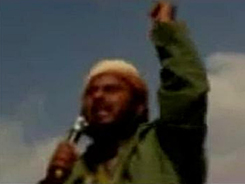A man identified by extremist websites as Mohammed al-Kalwi, an al-Qaeda activist, delivers a eulogy on a video for militants killed in a Yemeni airstrike on a militant training camp to a large gathering of militants. He warned Yemeni forces against cooperating with Americans.