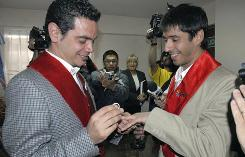 Jose Maria Di Bello. left, and his partner Alex Freyre exchange rings as they get married at a government's registry office in Ushuaia. Di Bello and Freyre wed in Latin America's first same-sex marriage on Monday.