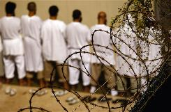 Detainees gather during an early morning Islamic prayer at the Guantanamo Bay prison.