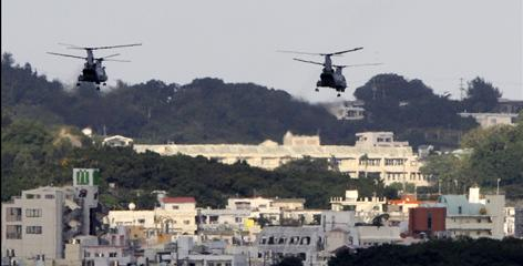 U.S. military helicopters flying over the U.S. Marine Corps Futenma Air Base in Ginowan, Okinawa Prefecture.