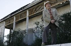 Bobby McIntyre, an advocate for the preservation of the Halfway House, stands in front of the turn-of-the-century New Orleans dance hall that is targeted for demolition.
