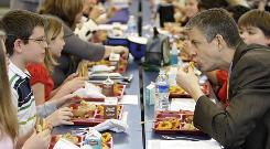 Education Secretary Arne Duncan has lunch with students at Eagle Intermediate School in Martinsburg, W.Va.