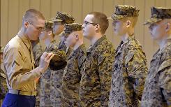 Marine Pfc. Brian Watkins, a graduate of the Asheville High JROTC program, inspects cadets. The Marine Corps has placed the program on probation for failure to maintain at least 100 students.