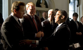 Then President-elect Obama shakes hands with California Gov. Arnold Schwarzenegger.