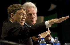 Former President Bill Clinton speaks with Microsoft chairman Bill Gates at the World Aids Conference in Toronto in August 2009. A donor list, released on New Year's Day by the William J. Clinton Foundation, shows that the Bill and Melinda Gates Foundation gave to the charity.