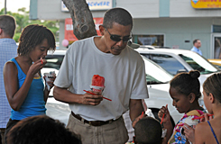 President Obama eats shave ice with his daughters Malia, left, and Sasha outside Island Snow in Kailua, Hawaii, on Jan. 1.