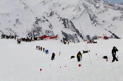 This picture taken on Sunday and released by Bern's regional police on Monday shows rescuers at a site where two avalanches bore down the Diemtigtal Valley, Bernese Alps.