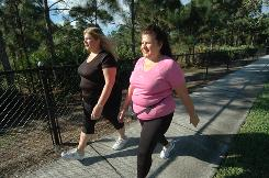 Fran Buckley takes a morning walk with her sister Jonna Convery in Jupiter, Fla. Buckley has lost about 30 pounds since late September.