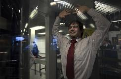 An employee of Schiphol stands inside a body scanner during a demonstration at a press briefing on Dec. 28. Amsterdam's Schiphol Airport was using 15 full-body scanners on flights to the U.S. and Dutch officials announced Monday they will buy 60 more scanners.