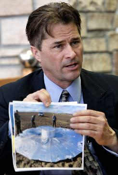 Richard Heene holds police evidence photos showing his balloon during an interview in Fort Collins, Colo., on Friday. Heene now says there was no balloon hoax, even though he pleaded guilty and agreed to be sentenced to 90 days in jail. He says he pleaded guilty to appease authorities and save his wife from being deported to Japan.