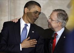 President Obama talks with Senate Majority Leader Harry Reid on the Hill in October. Reid apologized to the president Saturday after remarks he made in 2008 surfaced, drawing much criticism.
