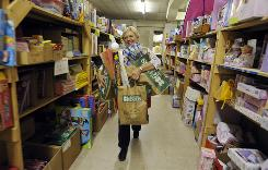 Linda Newton volunteers with the Christmas Cheer of Alamance County in Burlington, N.C., in November. During the application period in October, requests for the charity's assistance increased 20% over last year.