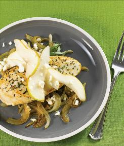 These oven-baked chicken breasts are topped with fresh sliced pears and feta cheese.