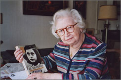 """Miep Gies displays a copy of her book """"Anne Frank Remembered"""" at her Amsterdam apartment in 1998."""