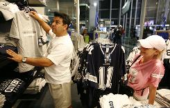 Ben and Melba Garcia of Fort Worth shop for Cowboys merchandise at the new Cowboys Stadium last March. A Supreme Court case could affect the price of such items.