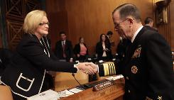 First-term Sen. Claire McCaskill, chairwoman of the homeland security subcommittee overseeing government contracts, greets Adm. Mike Mullen on Capitol Hill last month.