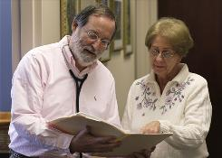 Dr. Stephen Glasser talks with his secretary Joann Peach before seeing a patient at his Baltimore office Jan. 12. Glasser used to care for about 3,500 patients, seeing between 25 and 30 a day. He pared the total down to between 600 and 700 when he converted to a concierge practice six years ago.