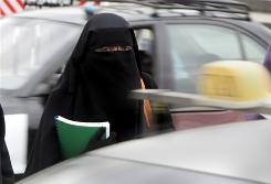 An Egyptian woman wears a niqab, which covers everything but the eyes, in Cairo. Egypt banned the niqab in college dormitories and some professions. France considered a niqab ban, fearing it will encourage extremism in the nation where Islam is the No. 2 religion.
