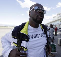 Musician Wyclef Jean arrives at the airport in Port-au-Prince on Wednesday.