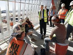 Sen. Harry Reid tours McCarran International Airport's new terminal in Las Vegas on Tuesday. The terminal is a stimulus-backed project.