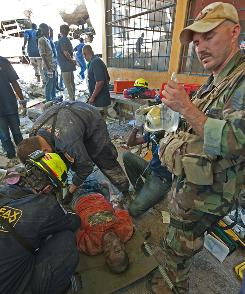 Student Billy Clerge, 27, gets medical aid Friday after he was carried from the rubble of the University of Port au Prince after being dug out by the Fairfax County (Va.) Urban Search & Rescue Team.