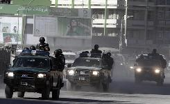 Afghan police officers arrive at the scene of attack in central Kabul on Monday. Taliban militants struck the heart of the Afghan government, prompting fierce gunbattles after a suicide bomber blew himself up near the presidential palace.