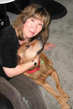 Tami Tanoue, a volunteer for MaxFund in Denver, provided hospice care for a stray dog named Copper for two months before he died.