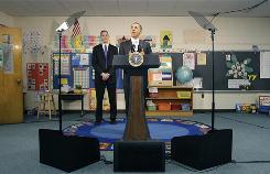 President Obama, accompanied by Education Secretary Arne Duncan, speaks to the media after a discussion with 6th-grade students at Graham Road Elementary School in Falls Church, Va., Jan. 19.