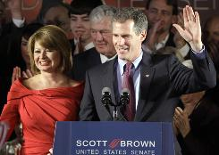 Republican Scott Brown celebrates his victory after claiming Edward Kennedy's long-held Senate seat in Boston on Tuesday night.