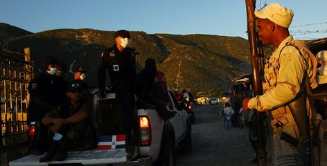 Search-and-rescue teams cross into Haiti from Jimani, Dominican Republic. Teams from other nations depended on land routes because of the airport in Port-au-Prince can't handle the influx of traffic.