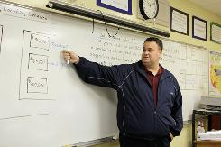 Robert Nolan teaches a personal finance class at Miami Springs High School in Miami Springs, Fla.