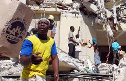 Men ransack a collapsed supermarket in Port-au-Prince on Thursday. Foreign medical teams worked feverishly today to stop countless more dying from massive injuries in Haiti, as rescue workers refused to abandon hope of pulling more survivors from the rubble.