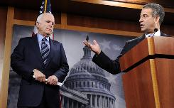 Sen. John McCain, R-Ariz., and Sen. Russ Feingold, D-Wis., pictured here Jan. 7, co-sponsored a bill in 2002 that imposed sweeping limits on campaign spending.