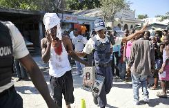 In Carrefour, Haiti, Michel Chedler, 28, gets protection from ploice after he claimed a mob beat him over his possession of a boombox.