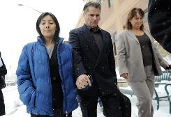 Richard Heene, center, and Mayumi Heene, left, walk out of the courtroom after their sentencing hearing at the Larimer County Justice Center Dec. 23, in Fort Collins, Colo.
