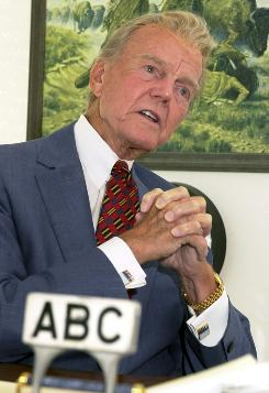 Paul Harvey, the news commentator and talk-radio pioneer whose staccato style made him one of the nation's most familiar voices, had close ties to the FBI, documents reveal. Photo shows Harvey in 2001.