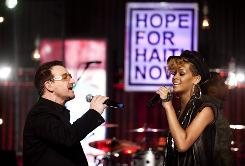 "Bono, left, and Rihanna perform at the ""Hope for Haiti Now: A Global Benefit for Earthquake Relief,"" Friday in London."