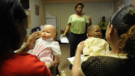 Evelyn Alverez, a Baby Basics educator, leads a class to help teen mothers keep themselves and their babies healthy in the Bronx, N.Y., in 2008.