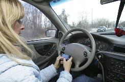 Tina Derby sends text messages while driving in Concord, N.H.