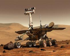 "The Mars Spirit Rover, as seen in this artist's rendering, is expected to ""survive"" winter on Mars, though its electronics will be ""hibernating."""