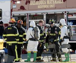 A hazmat team arrives at a Montgomery, Ala., court buidling on Jan. 5 after mail was found containing suspicious powder.