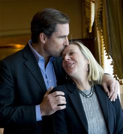 ABC newsman Bob Woodruff kisses the forehead of his wife, Lee, who cared for him after he suffered a traumatic brain injury while embedded in Iraq. They now work to help Iraq and Afghanistan war veterans who've suffered TBI and PTSD.