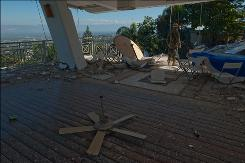 A Chilean recovery worker inspects what's left of the collapsed Hotel Montana in Port-au-Prince, Haiti, last week.