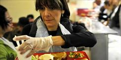 Michelle Pallari serves up a free Christmas dinner at Glide United Methodist Church in San Francisco.