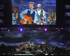 John Mellencamp, center, performs at the MusiCares Person of the Year tribute honoring Neil Young on Friday in Los Angeles.