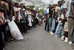 U.S. paratroopers from the 82nd Airborne keep women and men separate as they line up for aid at a distribution point in Port-au-Prince on Sunday.