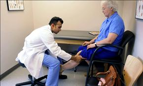 A doctor examines an elderly patient