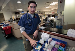 Frank McGeorge, an emergency room doctor at Henry Ford Hospital, stops at the supply cart in the Detroit facility after returning from Haiti. There, supplies were short, he says.